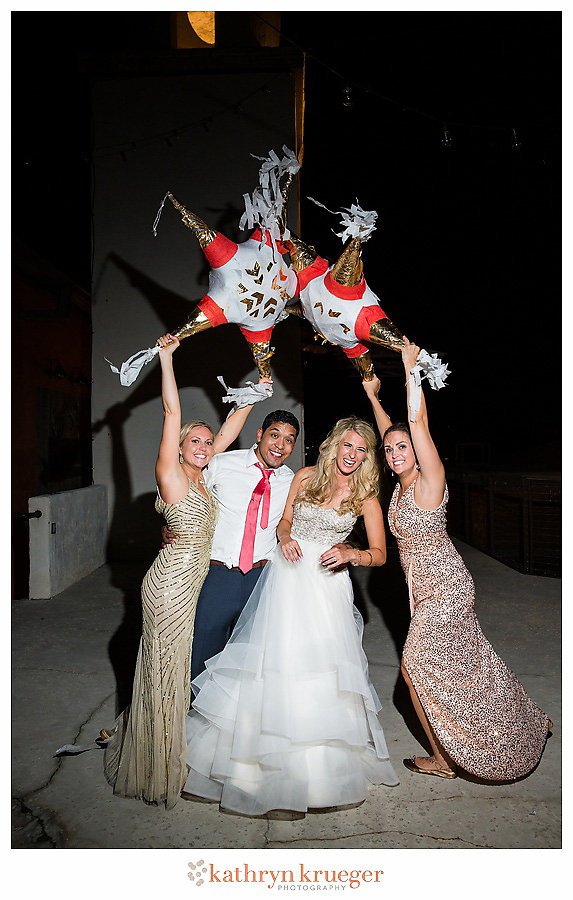 Bride groom bridesmaids with pinatas