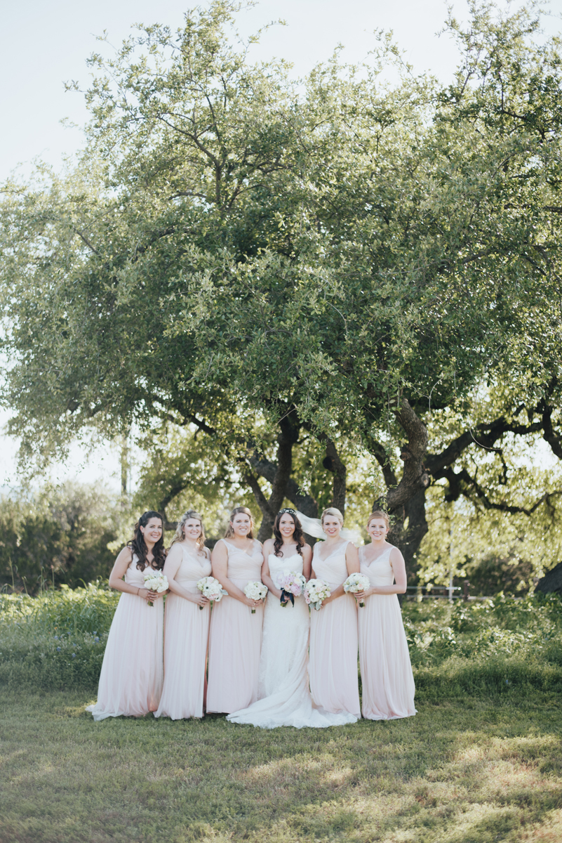 Bride with pink bridesmaids dresses