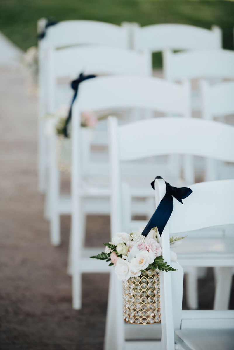 Floral pew markers white folding chairs