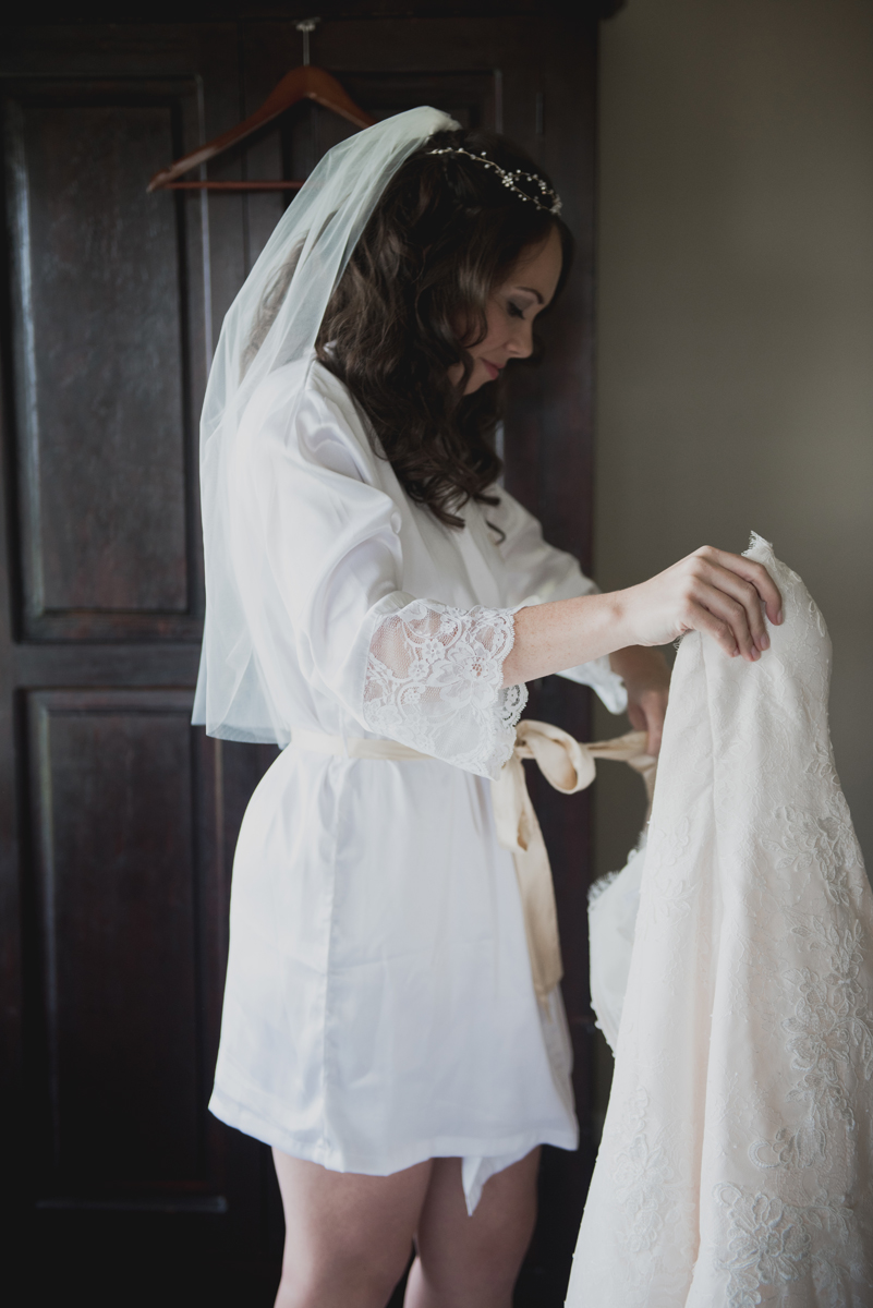 Bride in robe getting ready