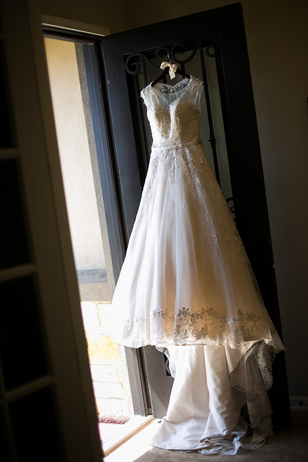 Wedding gown hanging on door