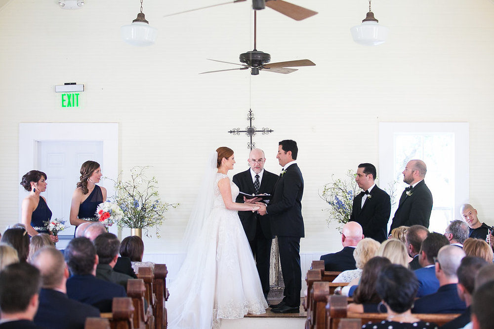 Wedding vows in Star Hill Ranch chapel