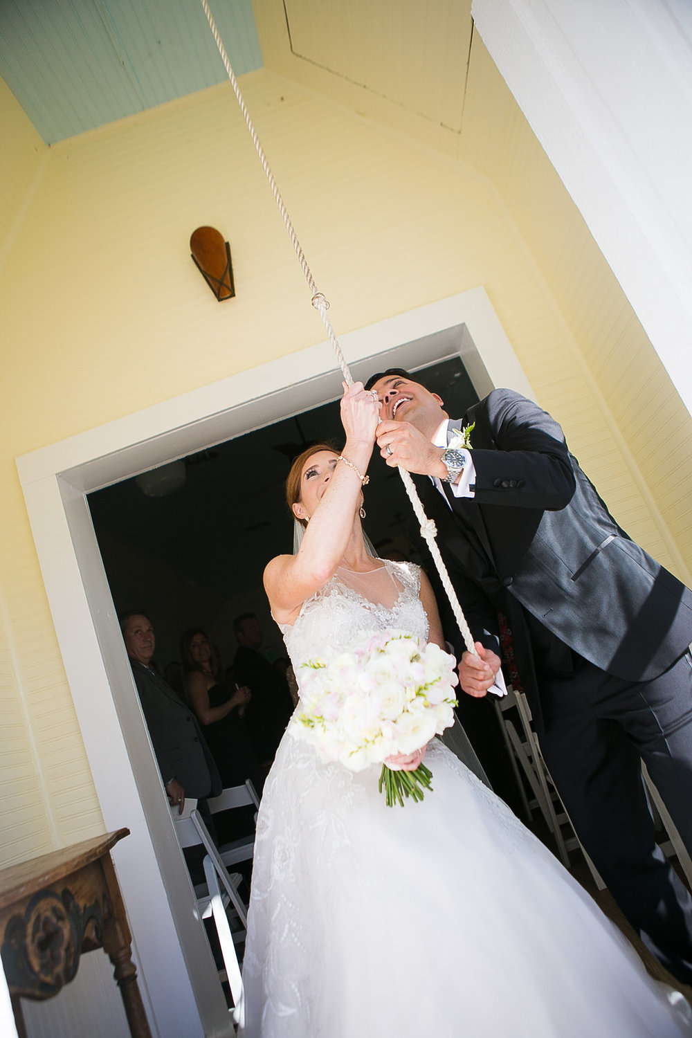 Bride & groom ringing bell at Star Hill Ranch chapel
