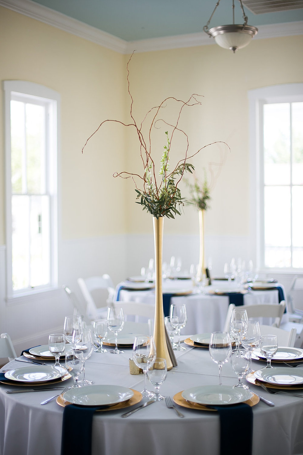 Tall gold branch & greenery centerpiece