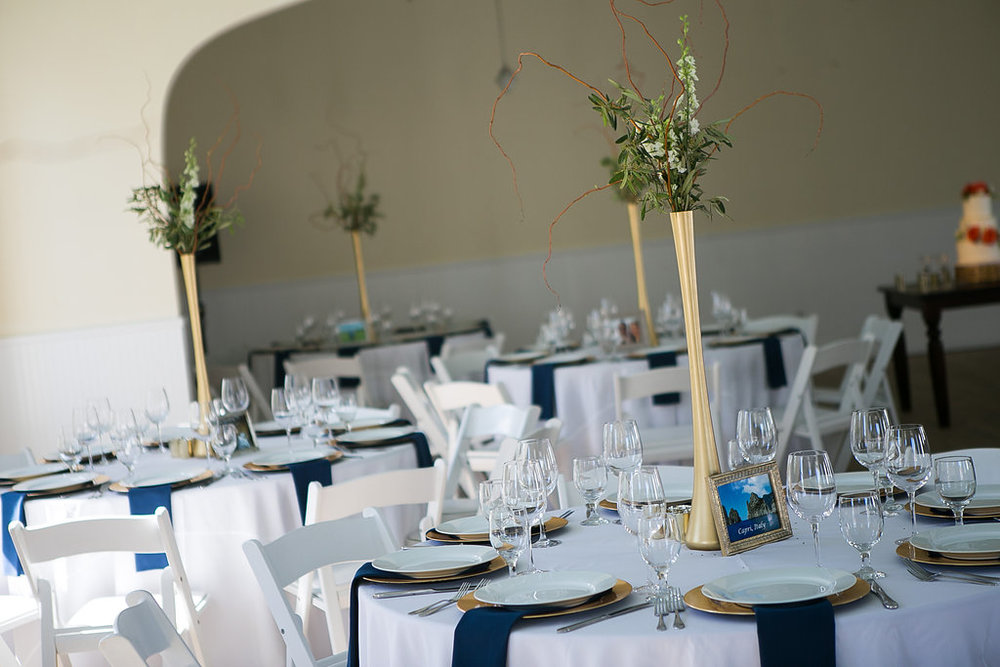 Tall gold branch & greenery centerpieces