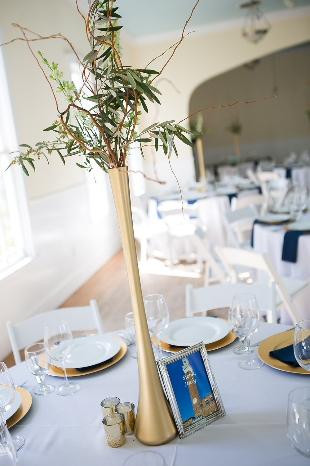 Tall gold branch & greenery centerpiece; travel table number