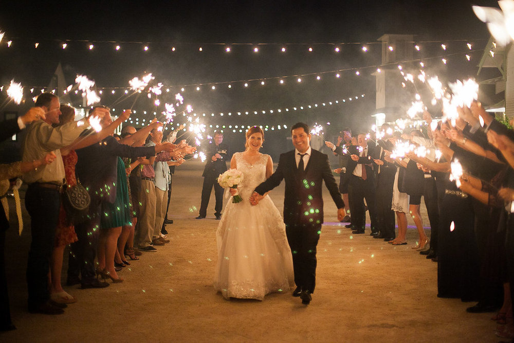 Wedding sparkler exit under cafe lights