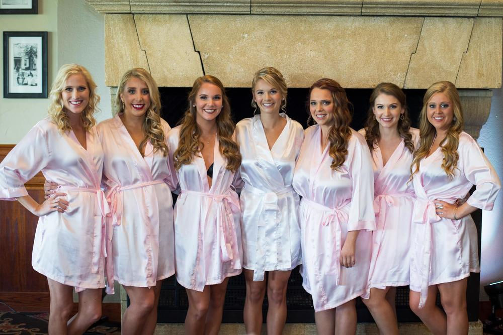 Bride & bridesmaids in pink & white robes