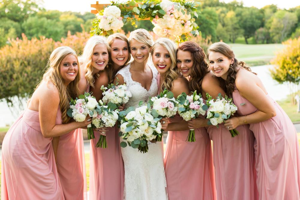 Bride & bridesmaids pink dresses white bouquets