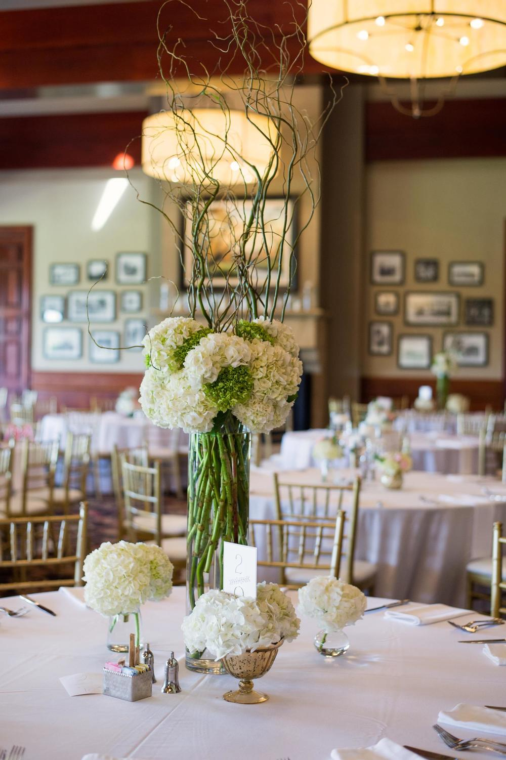Gleneagles Country Club tall branch green & white wedding centerpiece