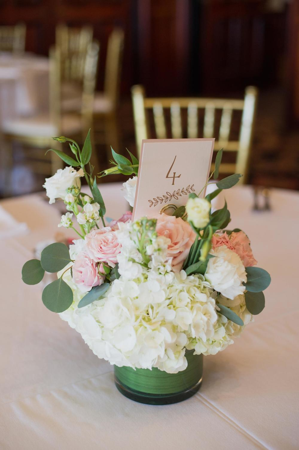 Low white pink centerpiece with Simply Personal table number