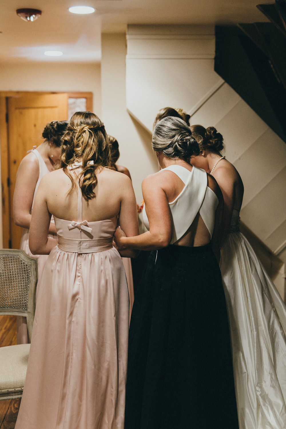 Mom, bride & bridesmaids praying before wedding at Brodie Homestead