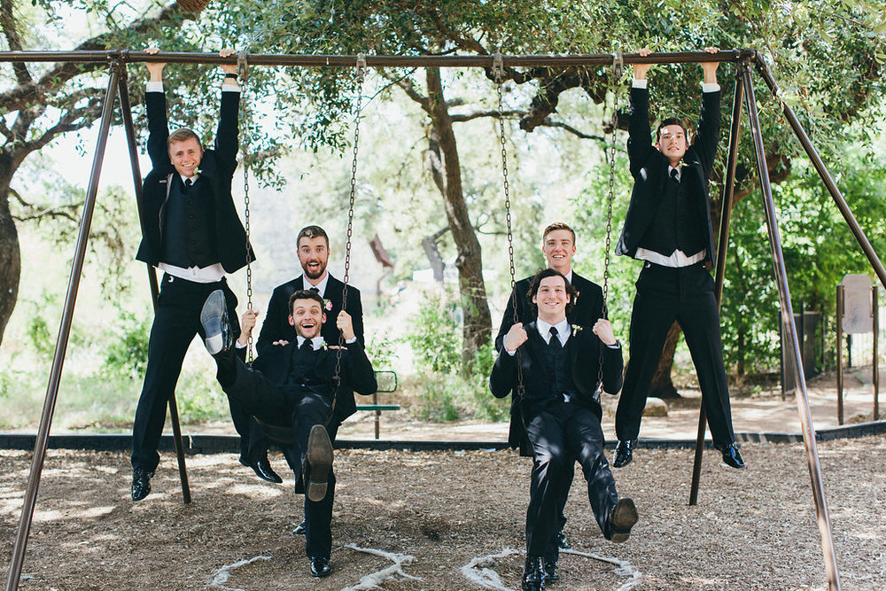 Groom & groomsmen on swingset - www.grantdanielsphotography.com