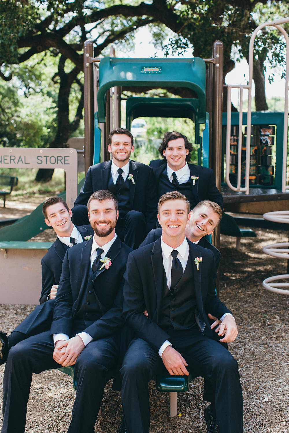 Groom & groomsmen on playground slide - www.grantdanielsphotography.com