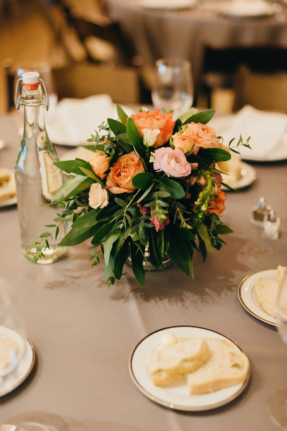 Wedding guest table gray linen; Wild Bunches orange, green, yellow centerpiece - www.grantdanielsphotography.com