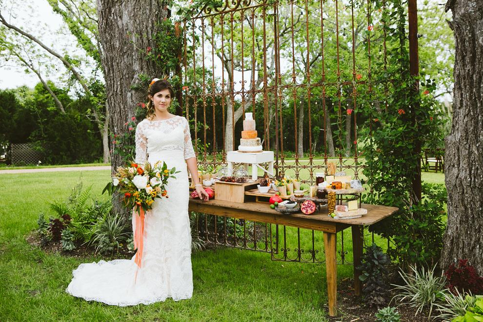 Bride at hors d'oeuvres table at Pecan Springs Ranch