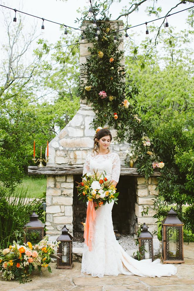 Brides of Austin styled shoot fresh fall boho bride near fireplace
