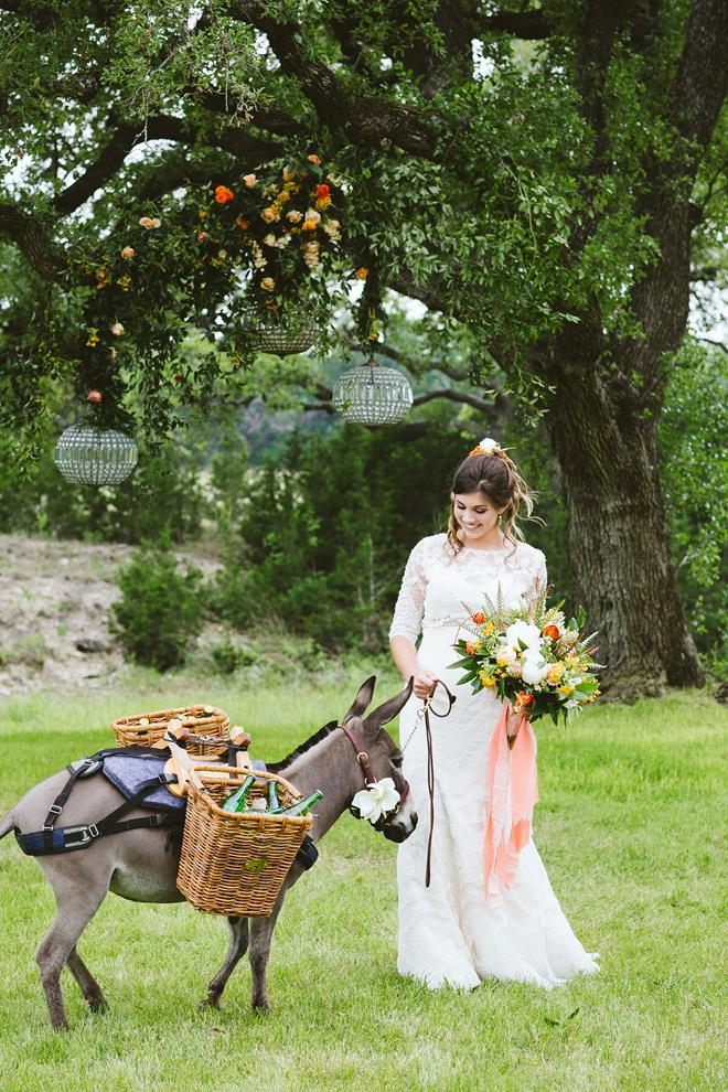 Bride with beer donkey at Pecan Springs Ranch