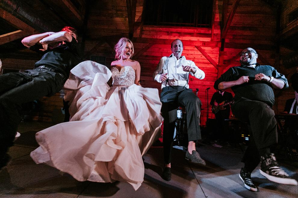 Kathryn & Mitch dancing on the stage | Kat Bevel Photography