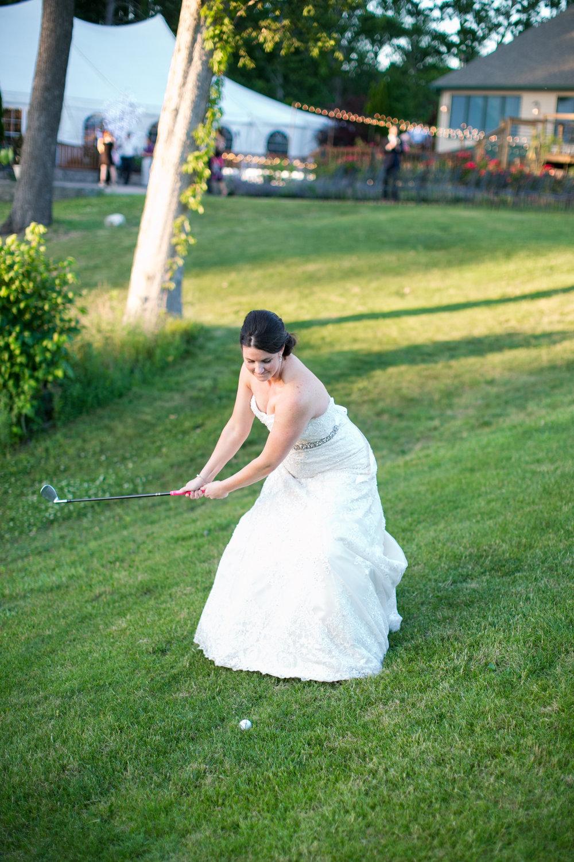 bride hitting golf ball.jpg