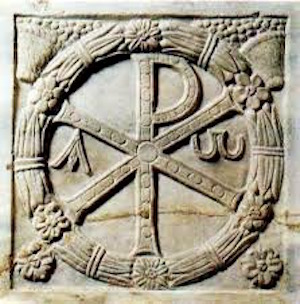 Ancient Chi Rho carved relief in Rome.