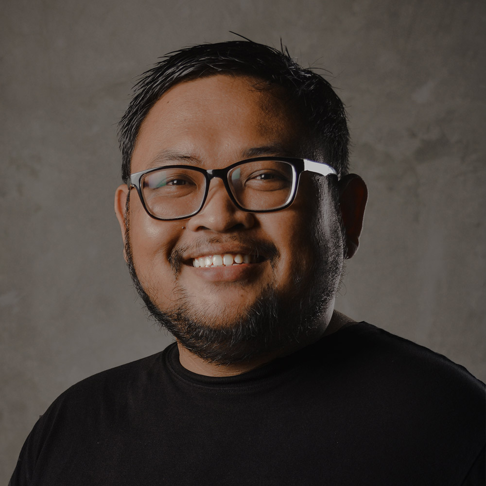 ARI PRASTYO  |Graphic Designer  Ari, or better known as Aryo, was born in Surabaya on August 14th, 1989. He studied at SMSR Surabaya and graduated with a major in DKV (graphic design) in 2008.  Later in 2016, Aryo joined Indigo as a graphic designer. His specialities are including conceptual design, graphic content, and branding. Therefore, he is responsible for concept making for signage, graphic content, and branding projects.   Download CV