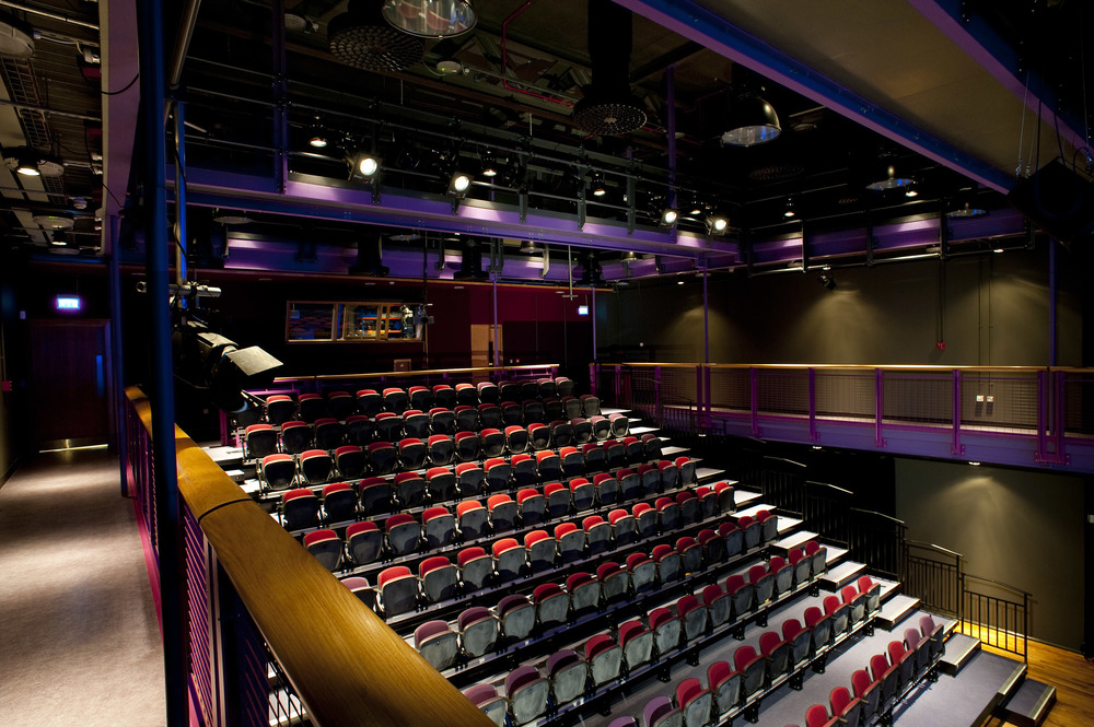 Auditorium seating, fixed and retractable for school theatre