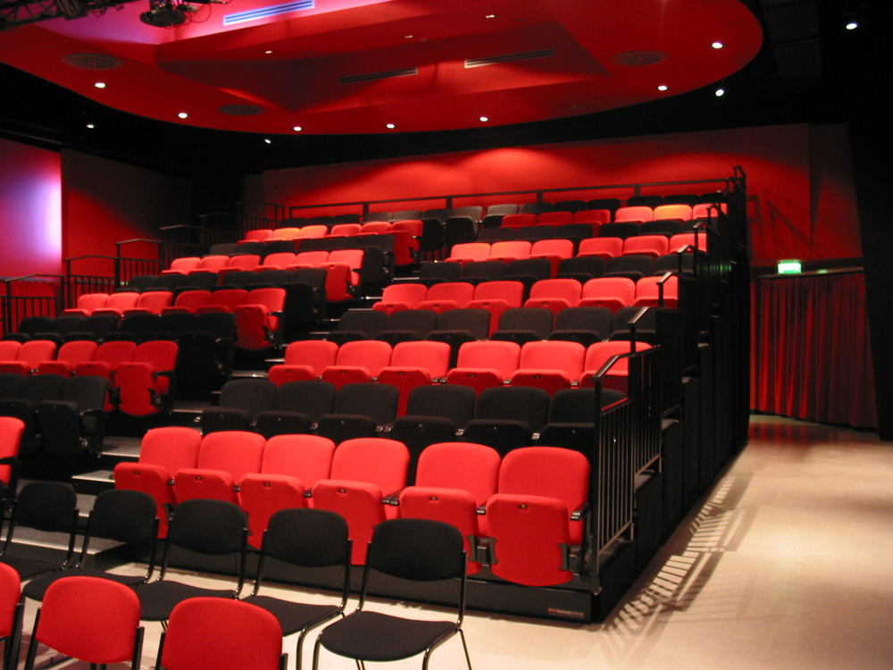 Retractable_theatre_seats_custom_colours.JPG