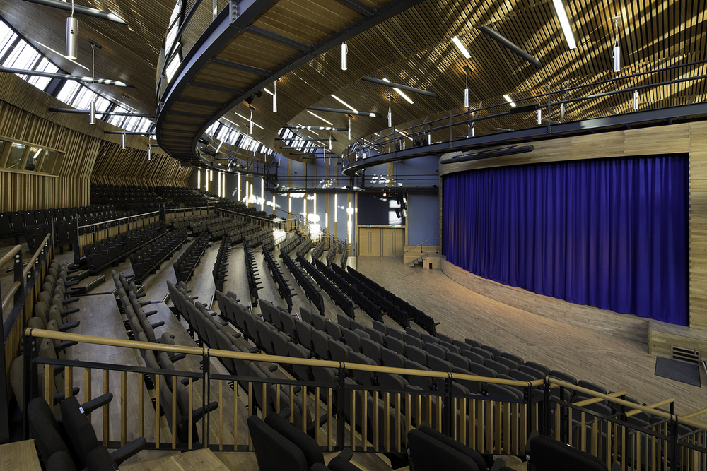 performing_arts_hall_retractable_platforms_fold_down_chairs.jpg