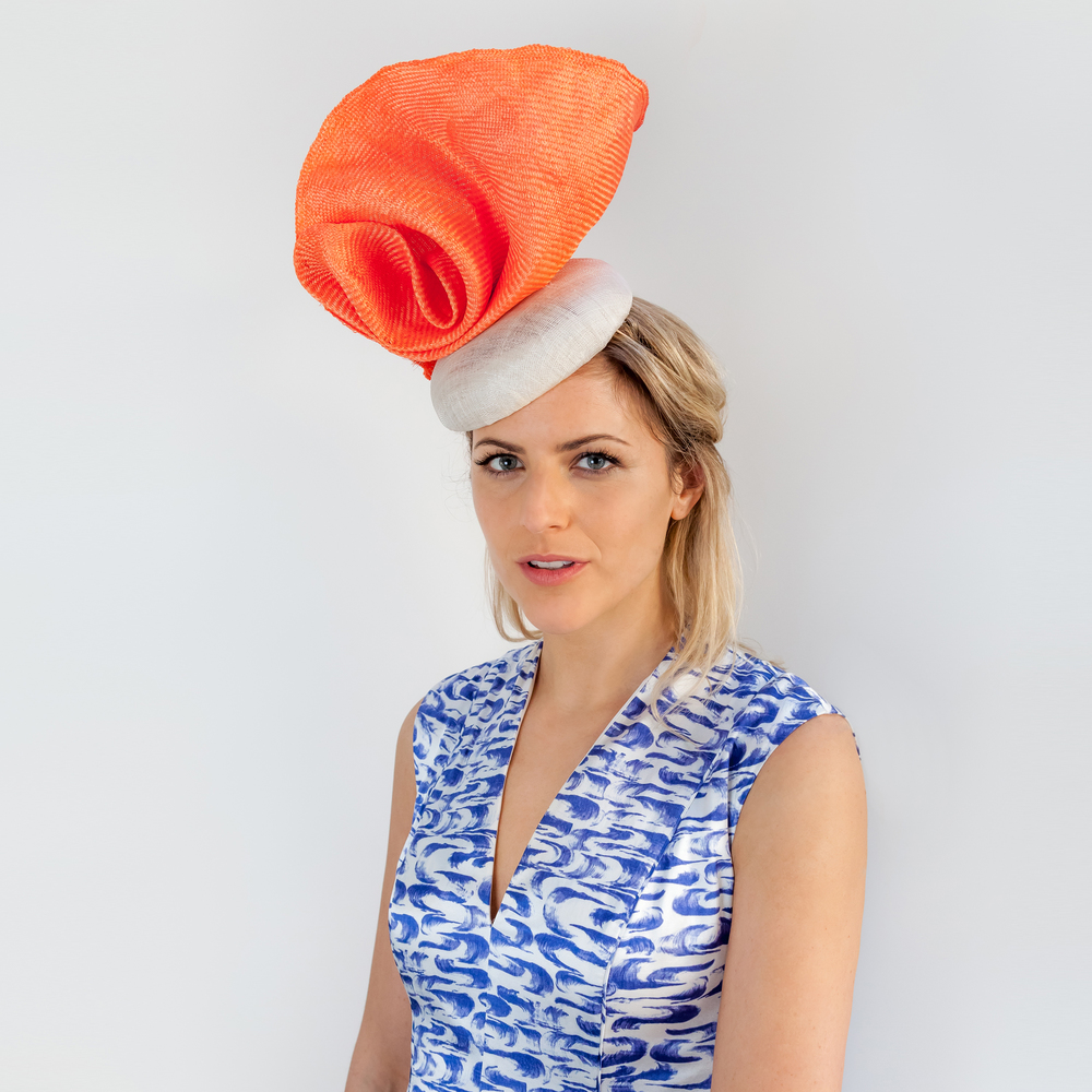 DISTORT - £70  Cream sisal straw button headpiece with orange frayed edge structural curl