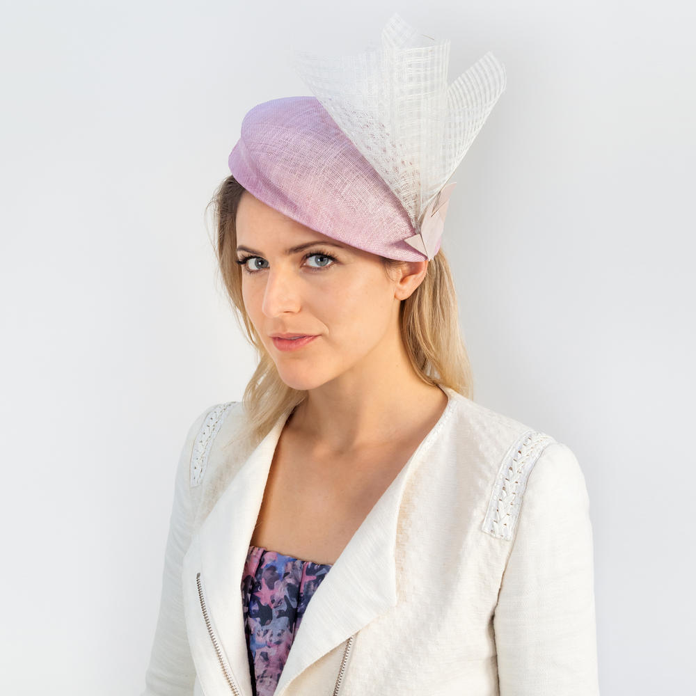 FACET - £65  Pale pink pinokpok beret with pierced straw spray and wood veneer shards.