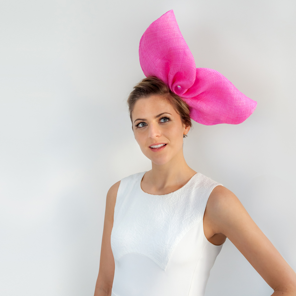 FORM - £65  Cream sisal straw button headpiece with pink sisal straw bow (base not shown).