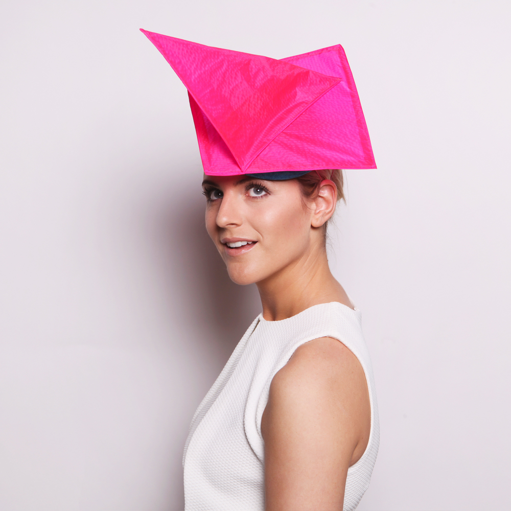 SPINNAKER - £65  Pale blue sisal straw button headpiece with abstract neon pink sails.