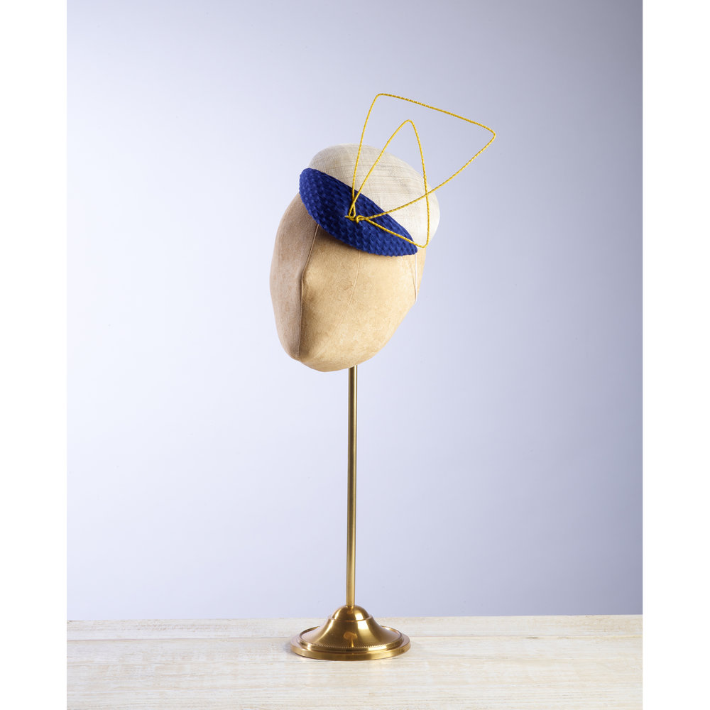 CANTILEVER - £65  Cream pinokpok button with contrasting royal blue fabric and abstract yellow wire.