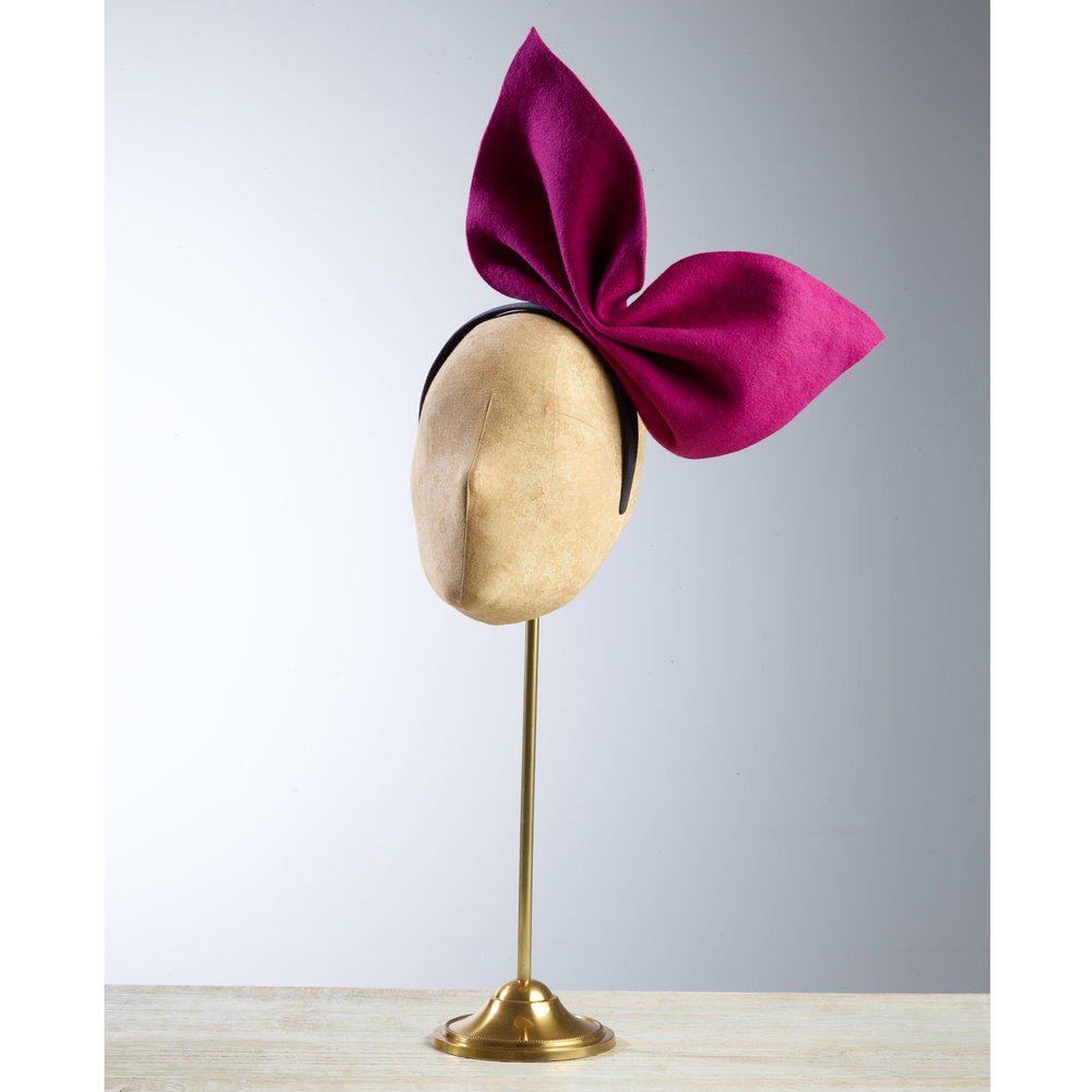 PAGODA - £60  Pink wool felt bow fixed onto a black hairband.