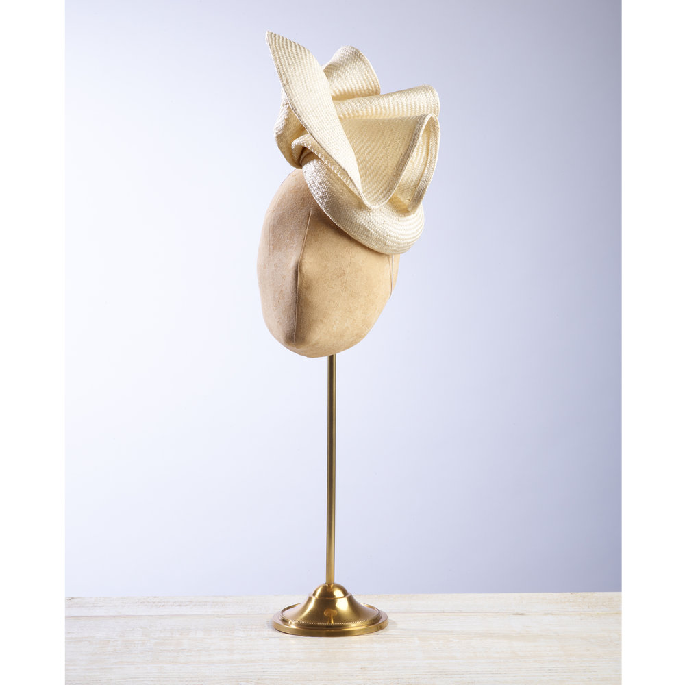 VOLUTE (Cream) - £80  Cream sisal straw button headpiece with matching structural folds.