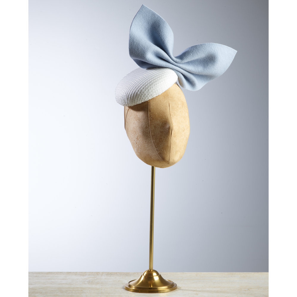 PLISSE - £75  White button headpiece with pale blue wool felt bow.