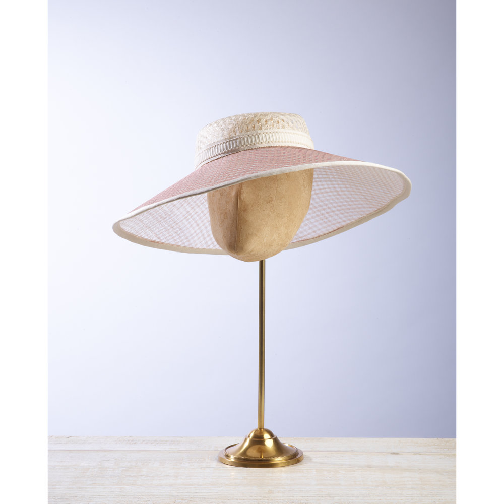 LATTICE - £100  Cream and pale pink pierced straw wide brimmed hat with cream braid.