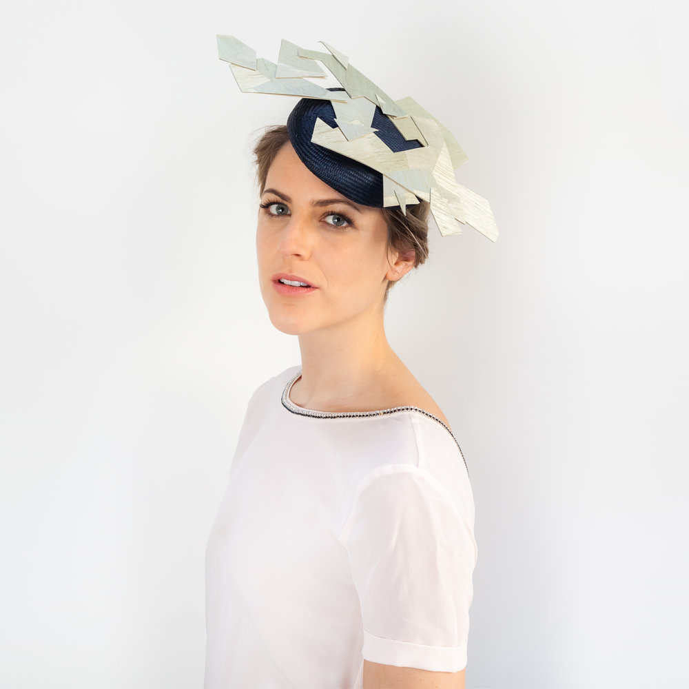 CUBIST - £75  Navy sisal straw button headpiece with wood veneer shards.