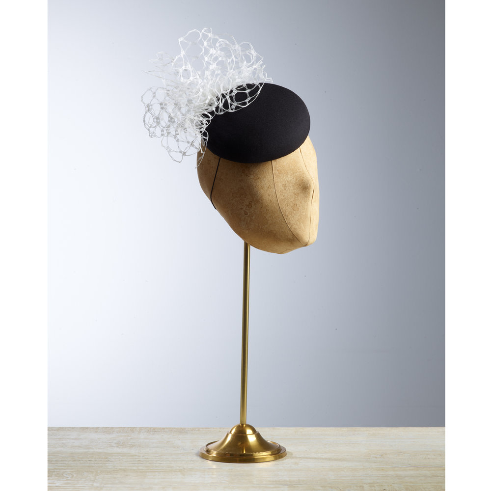 FLOUNCE - £75  A fun little classic button headpiece in black with white veiling detail.