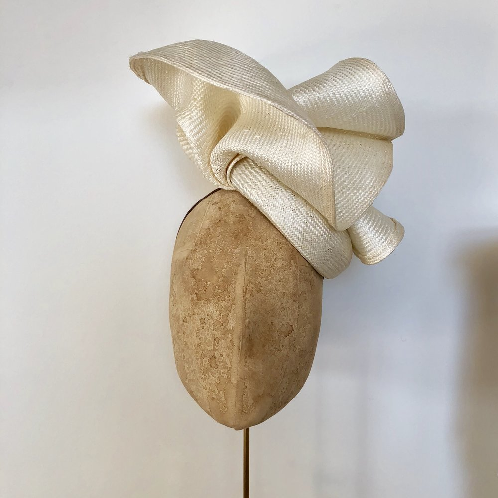 VOLUTE (Ivory) - £80  Cream sisal straw button headpiece with matching structural folds.