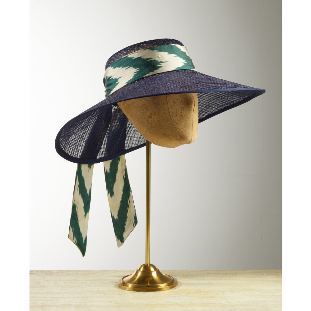 TREETOP - £100  Navy pierced straw wide brimmed hat with green and cream silk ikat trim.