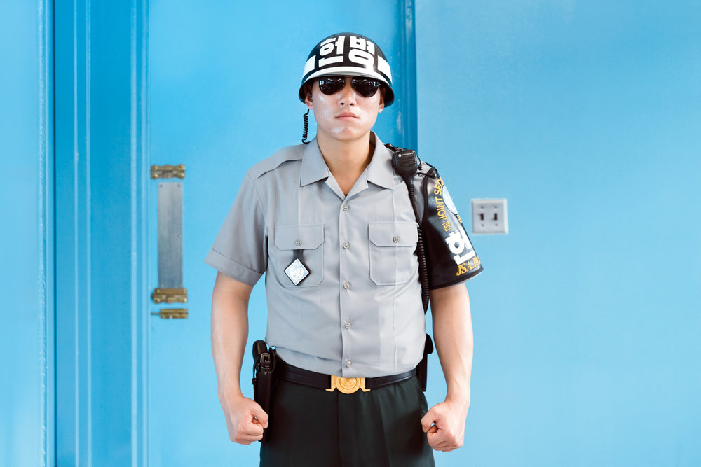 A South Korean ROK solider in the JSA, with the door to North Korea behind.