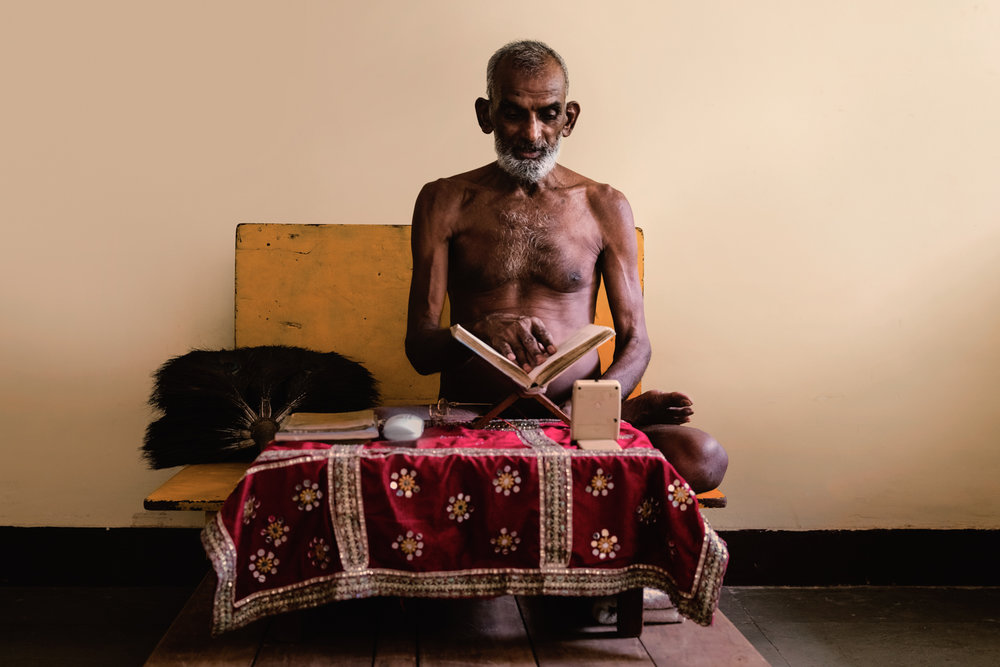 A Jain Priest sits in his retreat in Sanjay Gandhi National Park.