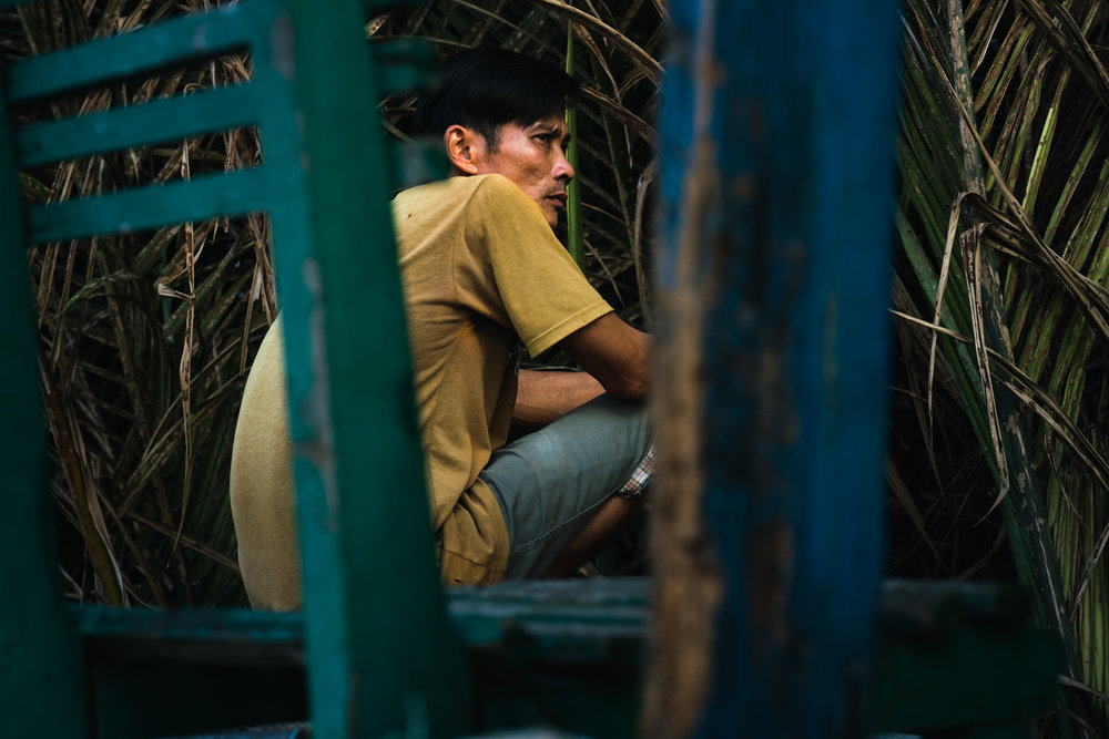 A fisherman takes a break on the Mekong Delta.