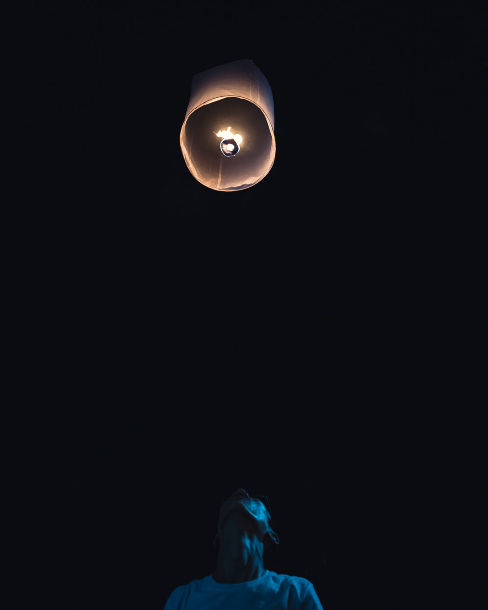 A man releases his sky lantern at the Loi Krahtong Festival.