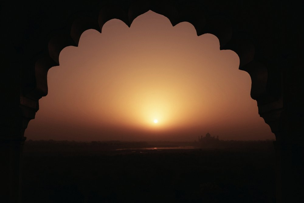 The Taj Mahal at sunrise from Agra Fort.