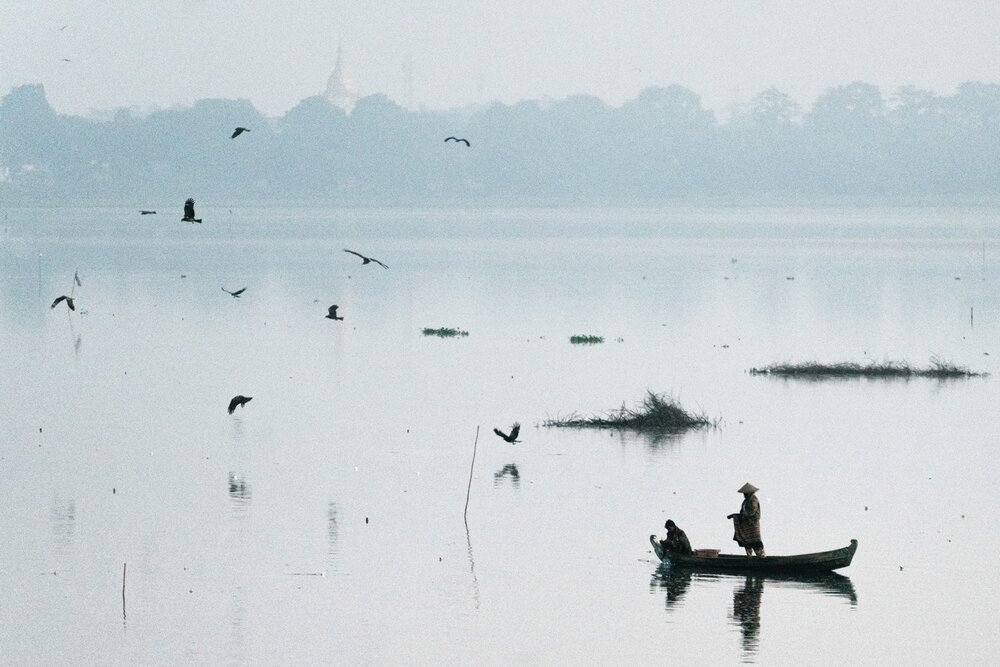 Fishermen at dawn on Taungthaman Lake.