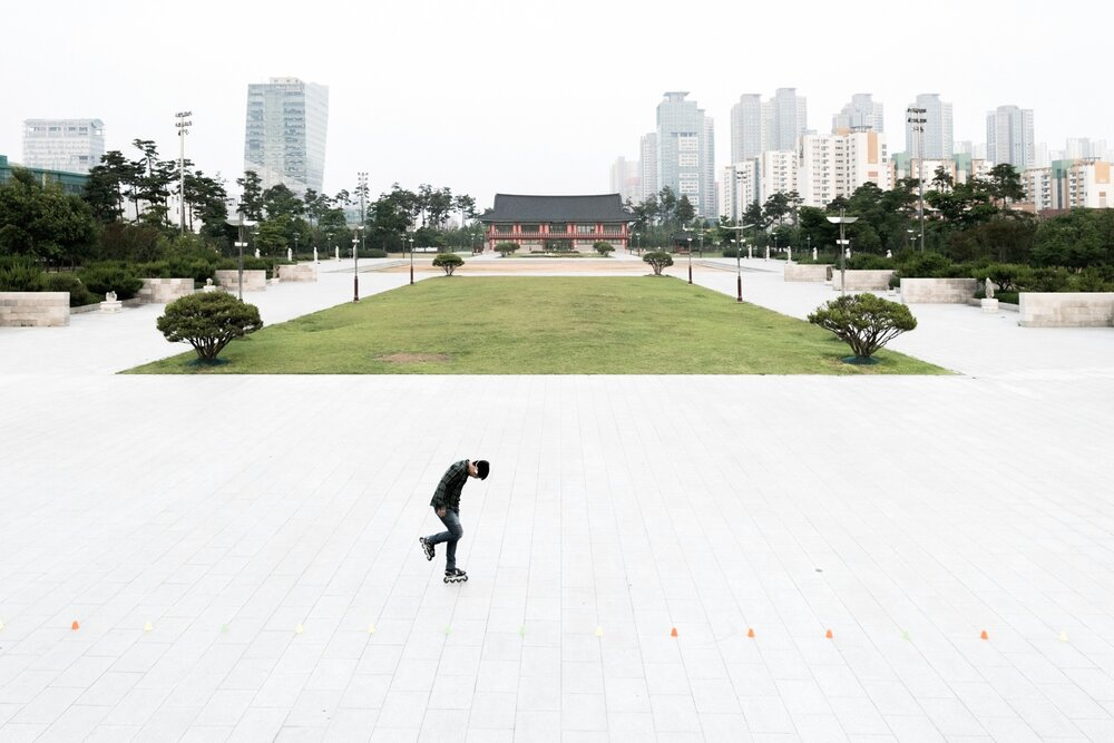 A man rollerblades alone in the masterplan city of Songdo.
