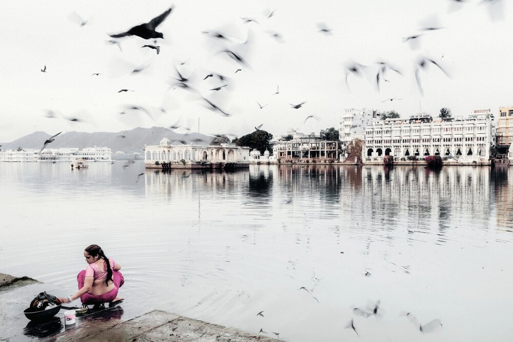 A woman washes her clothes in Lake Pichola.